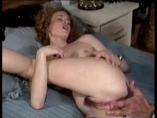 Curly haired brunette gets her ass drilled and then sucks cock